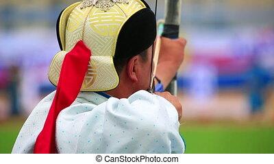 Naadam Festival Archery Tournament - Archer at Naadam...