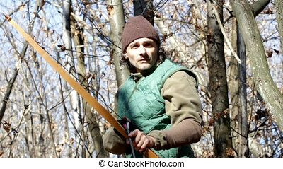 archer - man with a longbow in the woods