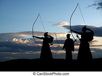 Archers - Japanese archer silhouette on sunset background