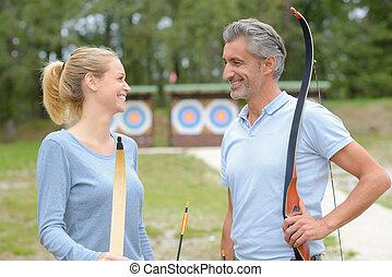 archers having a conversation