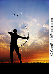 archery at sunset - archery silhouette at sunset