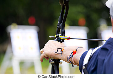 Archery holds bow aiming - archer holds his bow aiming at...