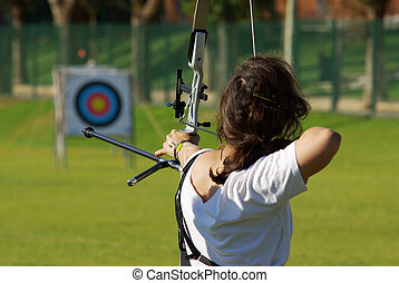 Archery Targeting - Back of archery athlete aiming at a...