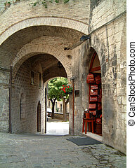 Arches Assisi - Street in Assisi showing an array of...
