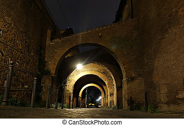 arches at night in Rome