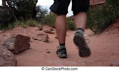 Arches Desert Trail Man Hikes Away