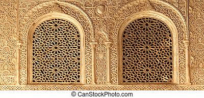 Arches in Islamic (Moorish) style in Alhambra, Granada, ...