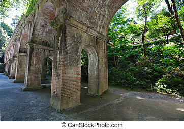 Arches under the aquaduct at Nanzen-ji in Kyoto, Japan.