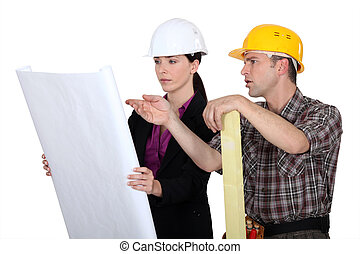Architect and builder discussing plans