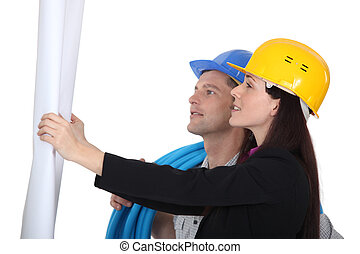Architect and builder looking at plans