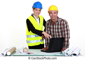 Architect and builder with laptop