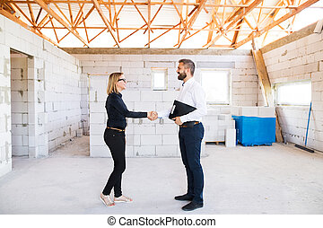 Architect and civil engineer at the construction site.