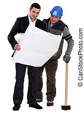 Architect and construction worker looking at plans