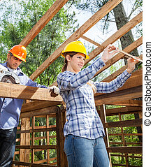Architect And Construction Worker Working At Site