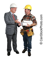 Architect and Contractor - an architect meeting with a...