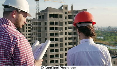 Architect and engineer discuss the project