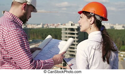 Architect and engineer looking on project