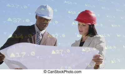 Architect and engineer reviewing plans