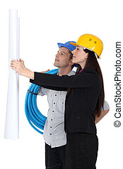 Architect and plumber looking at plans
