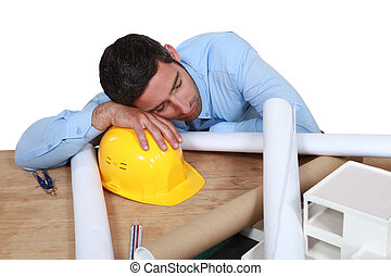 Architect asleep at his desk