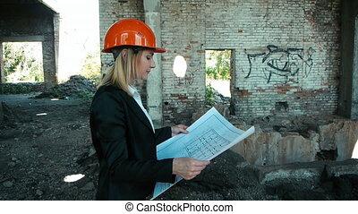architect builder engineer builder of ruined building looking girl