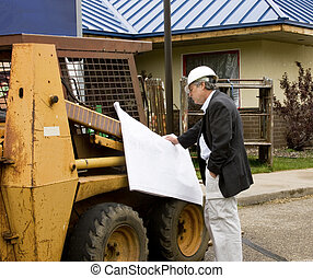 architect builder reading blueprints