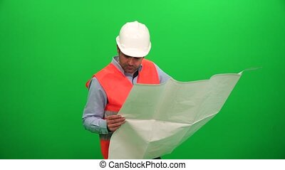 Architect Checking Technical Construction Drawings on Green Background
