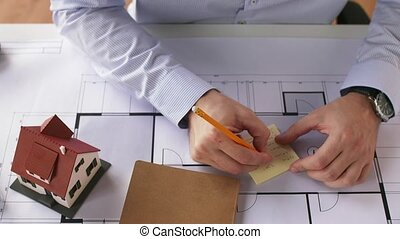 architect checking time on wristwatch and leaving -...