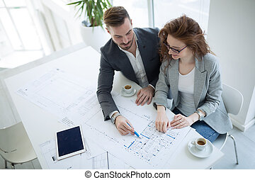 Architect colleagues working in office