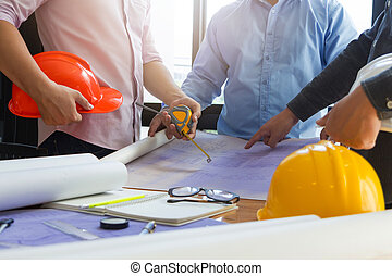 Architect concept, Architects working with blueprints in the office