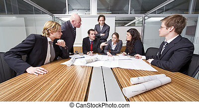 Architect cubicle - A group of six junior associates during...