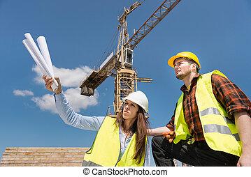 architect, de arbeider van de bouw, bouwterrein