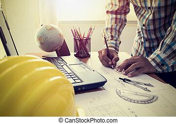 Architect drawing construction plan