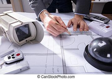 Architect Drawing Plan On Blueprint