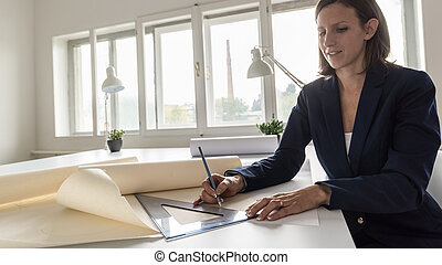 Architect drawing the blueprint of future building