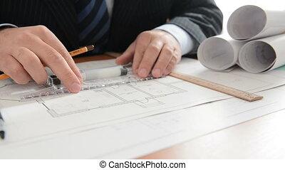 Architect draws a draft. Close view