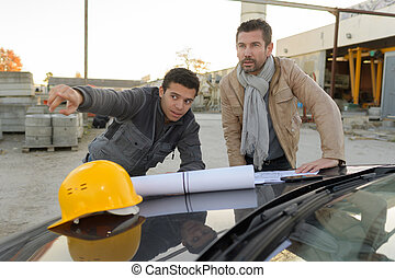 architect engineer project manager at construction site