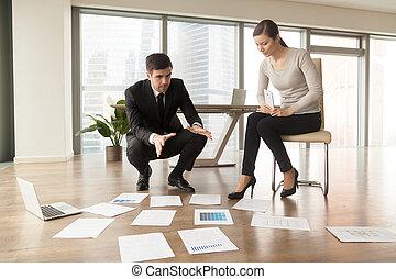 Architect explaining construction plan to client