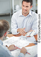 Architect explaining costs to client