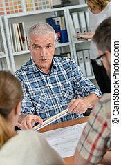 Architect explaining something to clients