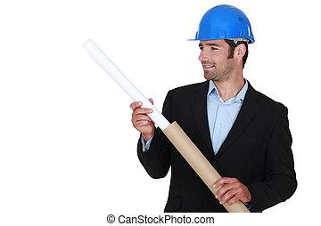 Architect fixing flat cardboard tube