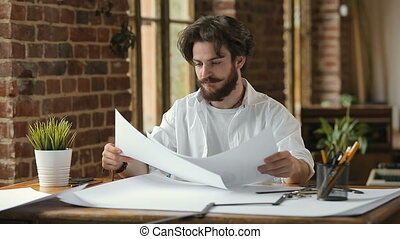 Architect Gets Stressed - Hard-working caucasian architect...