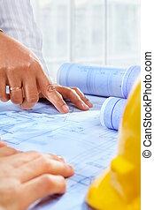 Architect hand working on paperwork