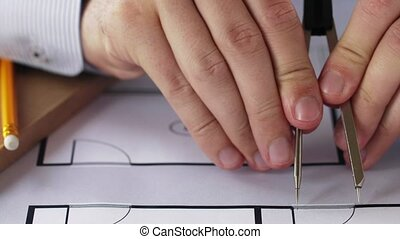 architect hands with compass measuring blueprint