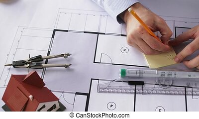 architect hands with ruler measuring blueprint -...