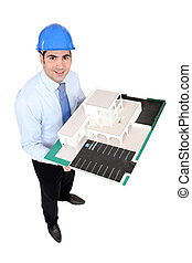 Architect holding a building model