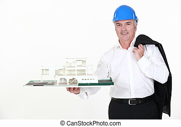 architect holding a miniature model of a house