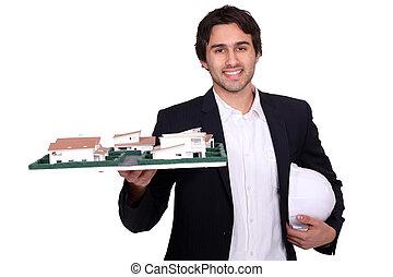 Architect holding a model