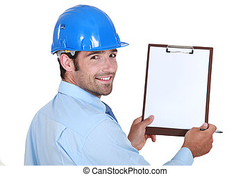 Architect holding clip-board and pen
