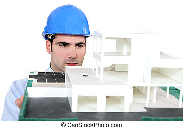 Architect holding his building model